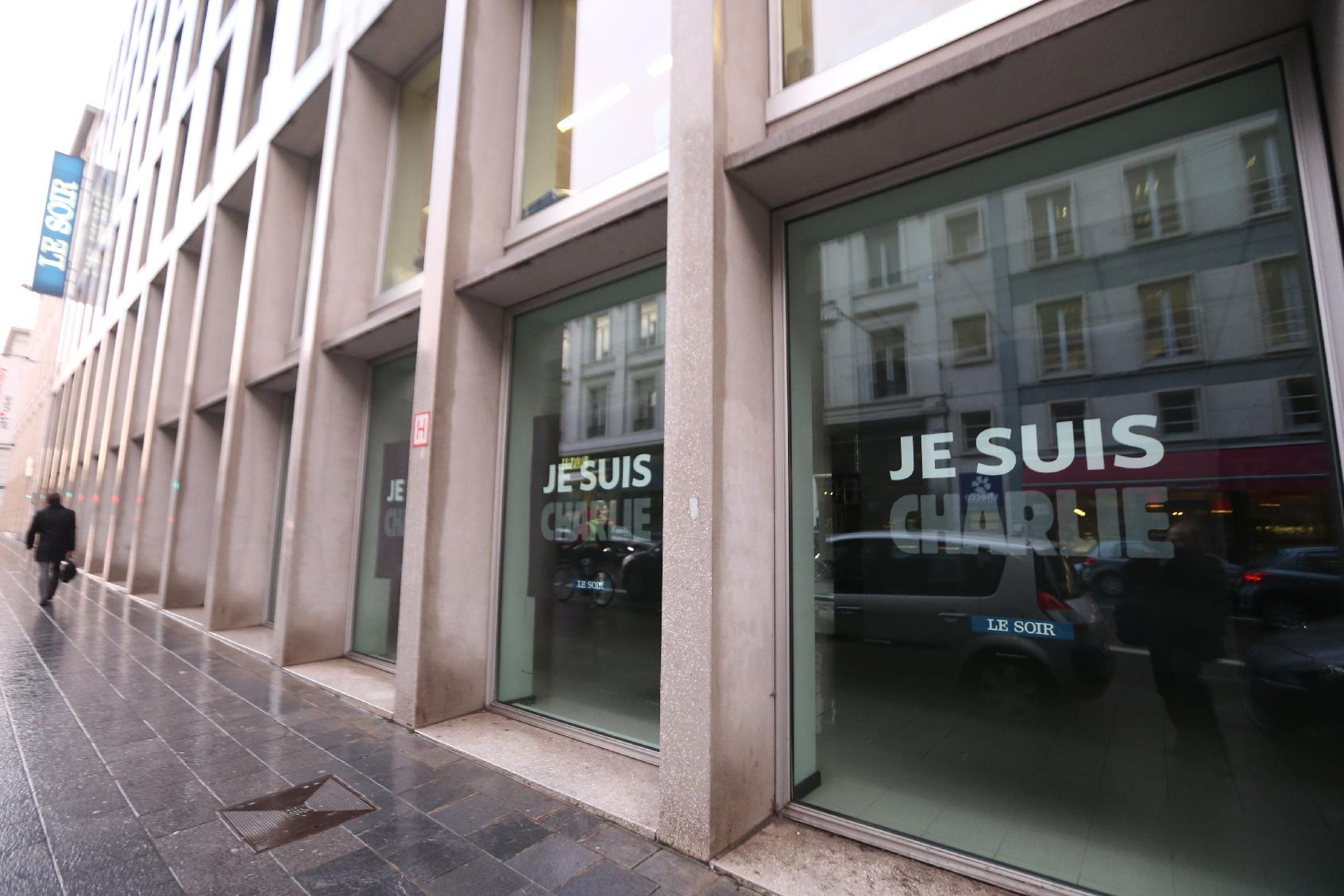 """The words """"Je suis Charlie"""" (I am Charlie) are displayed in the windows of the headquarters of Belgian newspaper Le Soir on January 8, 2015 in Brussels"""