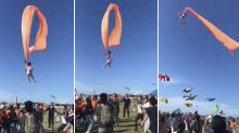 Terrifying moment girl taken away by kite at festival