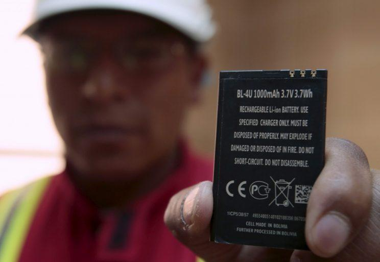 A worker holds a rechargeable lithium battery that is made in Bolivia at a plant in Llipi at the border of Uyuni salt lake, Bolivia, August 15, 2015. Bolivia's Evo Morales' government signed a contract with German company K-utec salt technologies to complete a lithium carbonate plant according to local media. (Photo: David Mercado/Reuters)