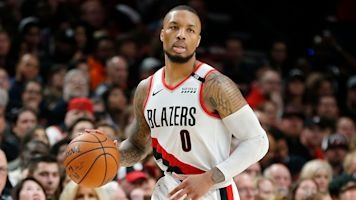Lillard reportedly playing with separated ribs