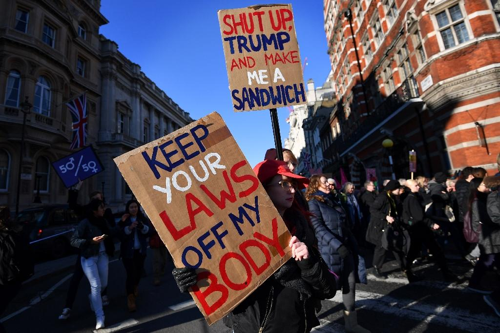 Protesters hold placards during the Women's March in London on January 21, 2017 as part of a global day of protests against new US President Donald Trump (AFP Photo/BEN STANSALL)