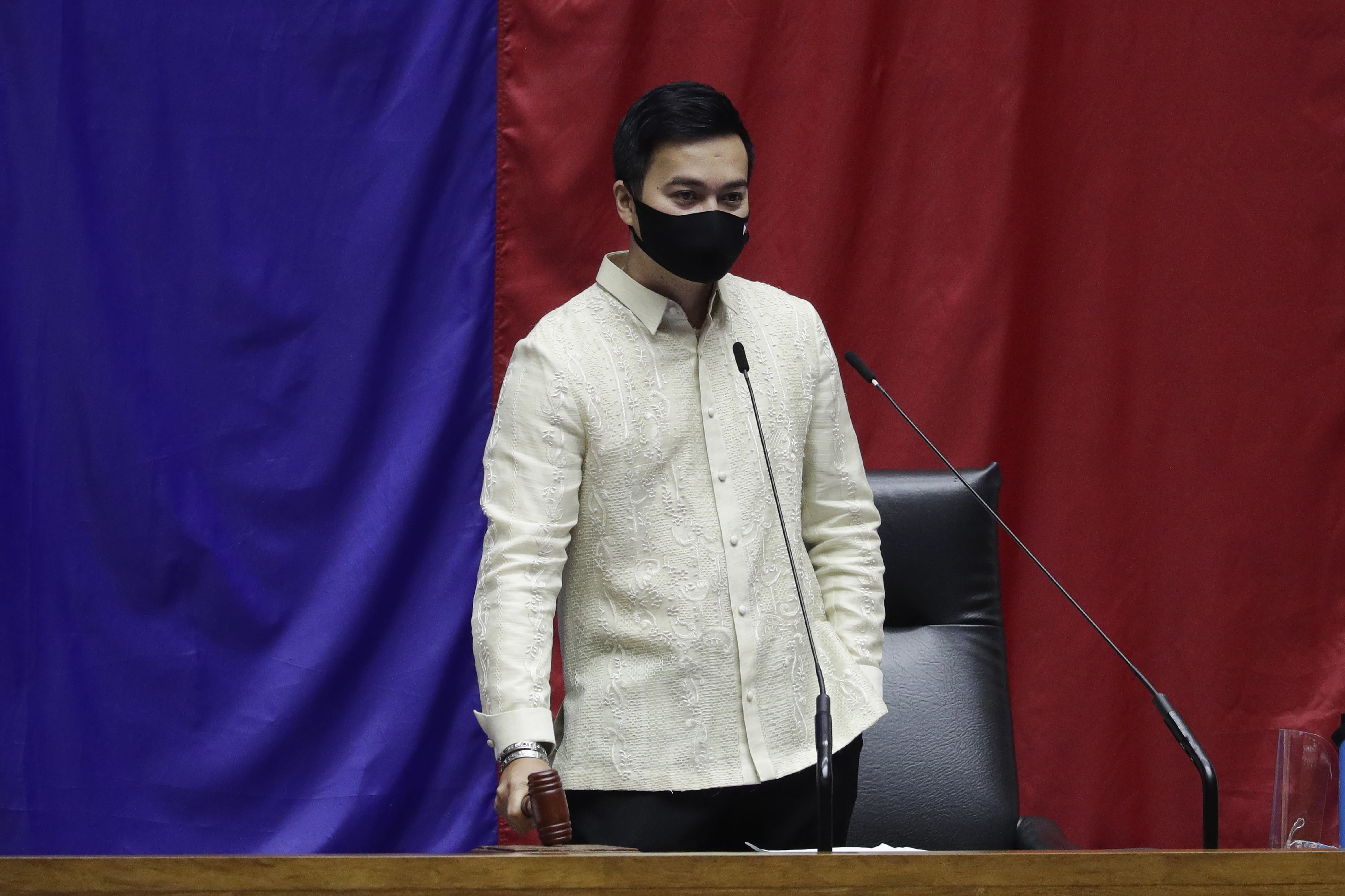 New House Speaker Lord Allan Velasco bangs the gavel during his first day at the House of Representatives in Quezon city, Philippines on Tuesday, Oct. 13, 2020. A large faction of Philippine legislators in the House of Representatives elected a new leader Monday in a tense political standoff between two allies of the president. (AP Photo/Aaron Favila)