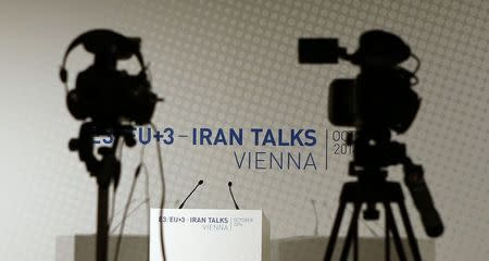 Video cameras are set up for a news conference prior to a meeting between EU foreign policy chief Catherine Ashton and Iranian Foreign Minister Mohammad Javad Zarif in Vienna in this October 14, 2014 file photo. REUTERS/Leonhard Foeger