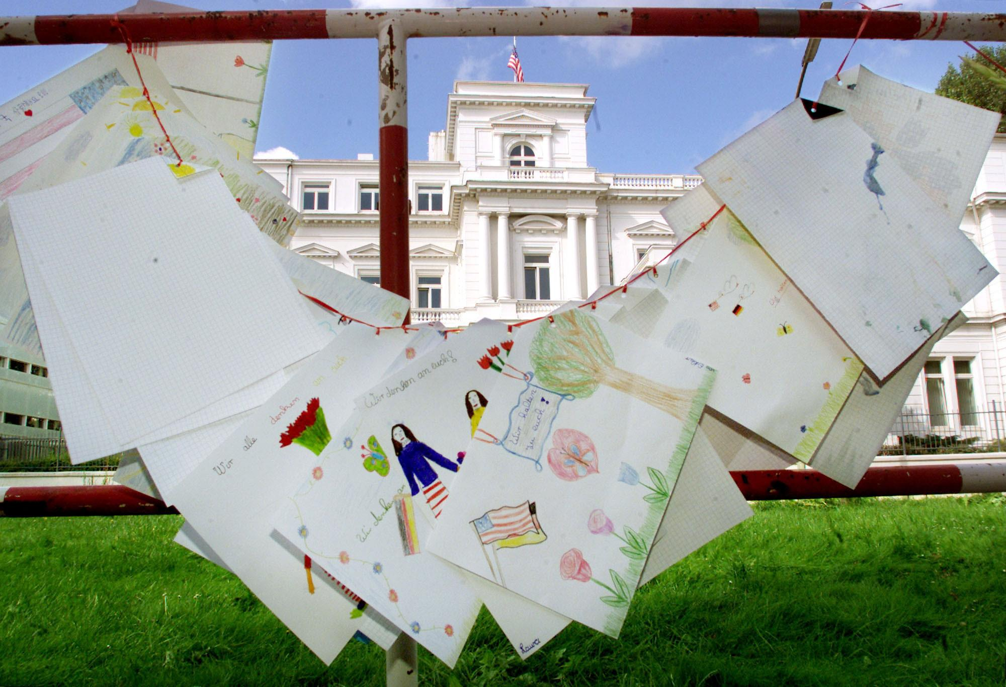 <p>Children's drawings expressing condolence over the victims of the terrorist attacks in the United States are fixed at the barriers in front of the U.S. consulate general in Hamburg, northern Germany, on Wednesday, Sept. 12, 2001. (AP Photo/Heribert Proepper) </p>