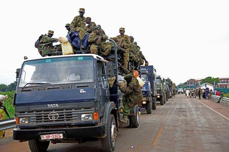 Uganda People's Defence Forces (UPDF) soldiers ride atop their military and police trucks enroute to evacuate their citizen following recent fighting in Juba at Nimule town along the South Sudan and Uganda border, July 14, 2016. REUTERS/Anthony Nambwaya