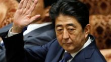 Japan PM revises when he knew about friend's vet school application