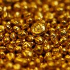 Gold steady as Fed caution on global economy pressures dollar