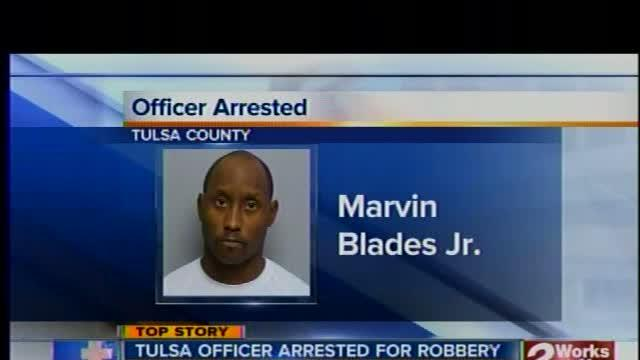 Tulsa police officer arrested, accused of robbery