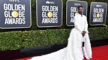 Billy Porter steals the Golden Globes spotlight in feathered tuxedo and train