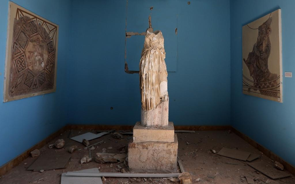 A beheaded and mutilated statue is seen in the museum detroyed by the Islamic State group in the ancient Syrian city of Palmyra (AFP Photo/Joseph Eid)