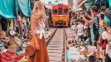 Travel blogger poses in front of moving train to get the perfect shot and people are confused and concerned