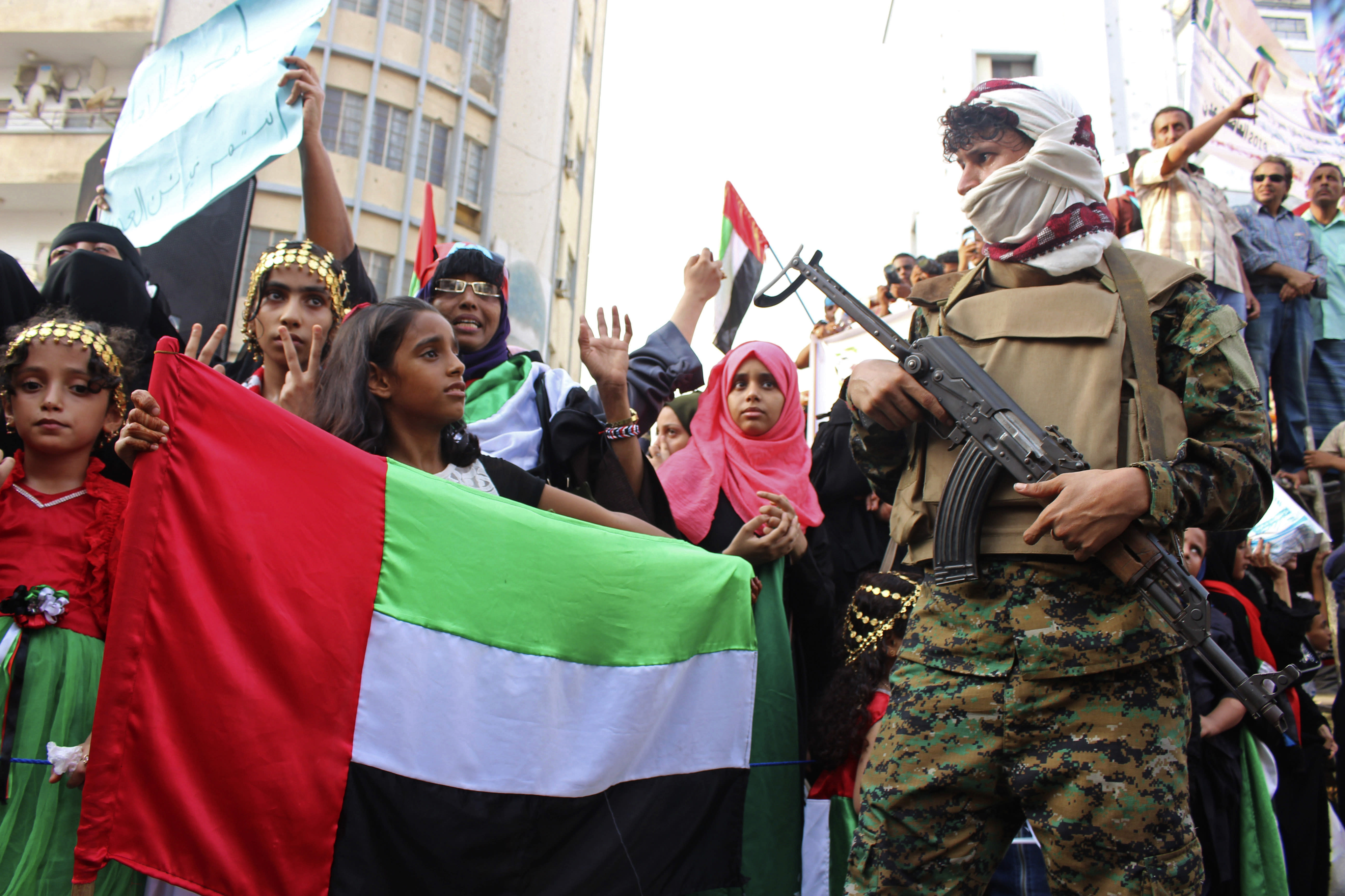 """FILE - In this Sept. 5, 2019 file photo, a girl holds the flag of the United Arab Emirates during a rally of supporters of southern separatists to show support for the UAE amid a standoff with the internationally recognized government, in Aden, Yemen. Human Rights Watch warned Monday, Sept. 14, 2020 that warring parties in Yemen's yearslong conflict are """"severely restricting"""" the delivery of desperately needed aid as the country slides toward famine amid the coronavirus pandemic. (AP Photo/Wail al-Qubaty, File)"""