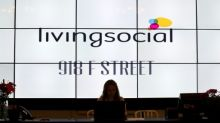 Groupon buys rival LivingSocial after reporting loss