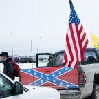 Confederate flag-bearing trucks park outside Michigan school