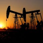 Oil prices fall on China economy worries, but output cuts support
