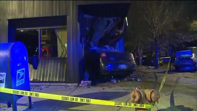 2 vehicles collide, sending one into building
