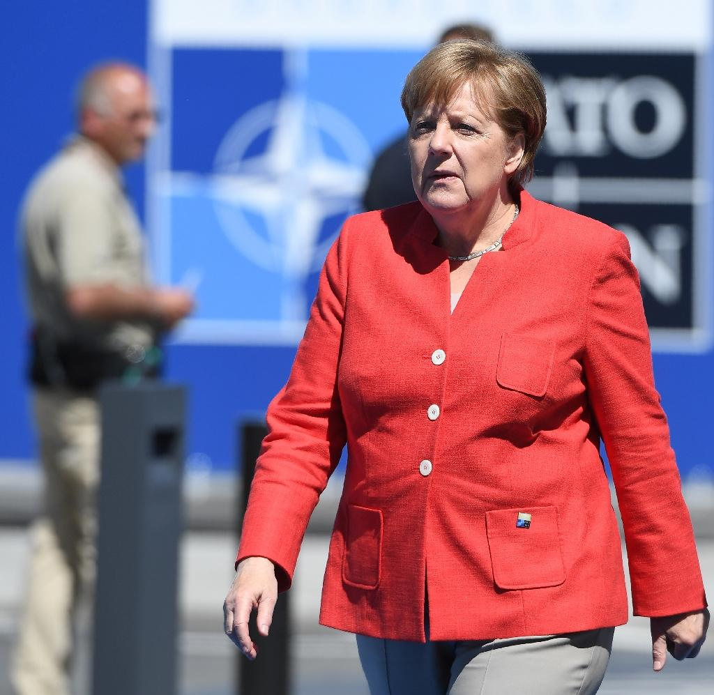 "German Chancellor Angela Merkel, pictured on May 25, 2017 in Brussels, said her discussion on climate change with US President Donald Trump was ""difficult and unsatisfactory"" (AFP Photo/Emmanuel DUNAND)"