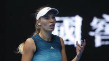 Wozniacki sets up potential showdown with Sharapova