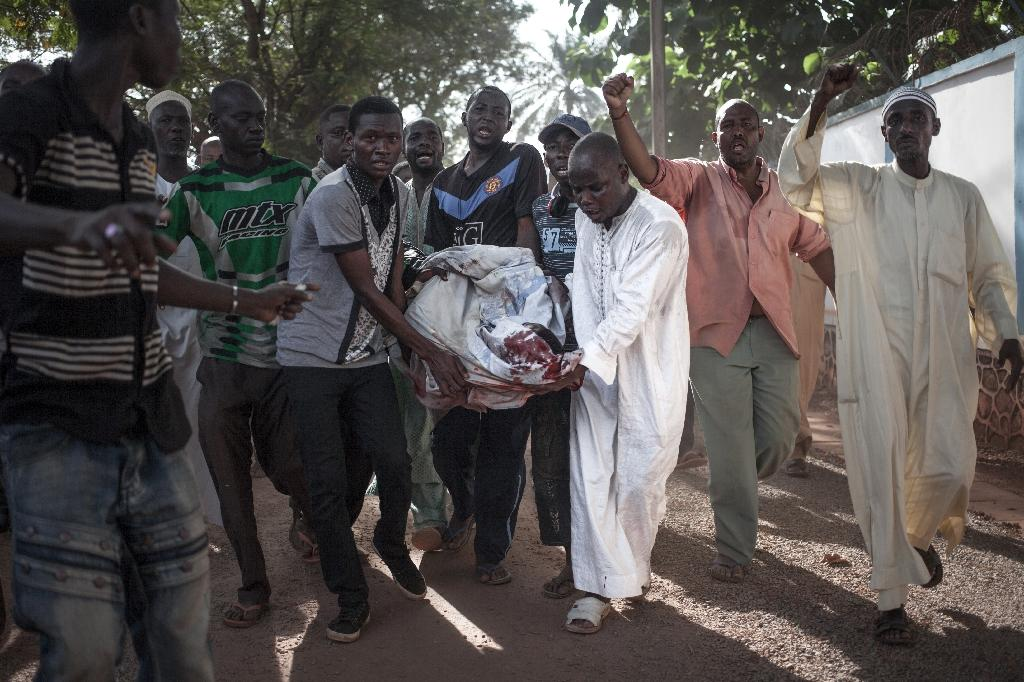 Protestors carried bodies of men killed in Tuesday's clashes and set them down in front of the UN peacekeeping mission (AFP Photo/FLORENT VERGNES)