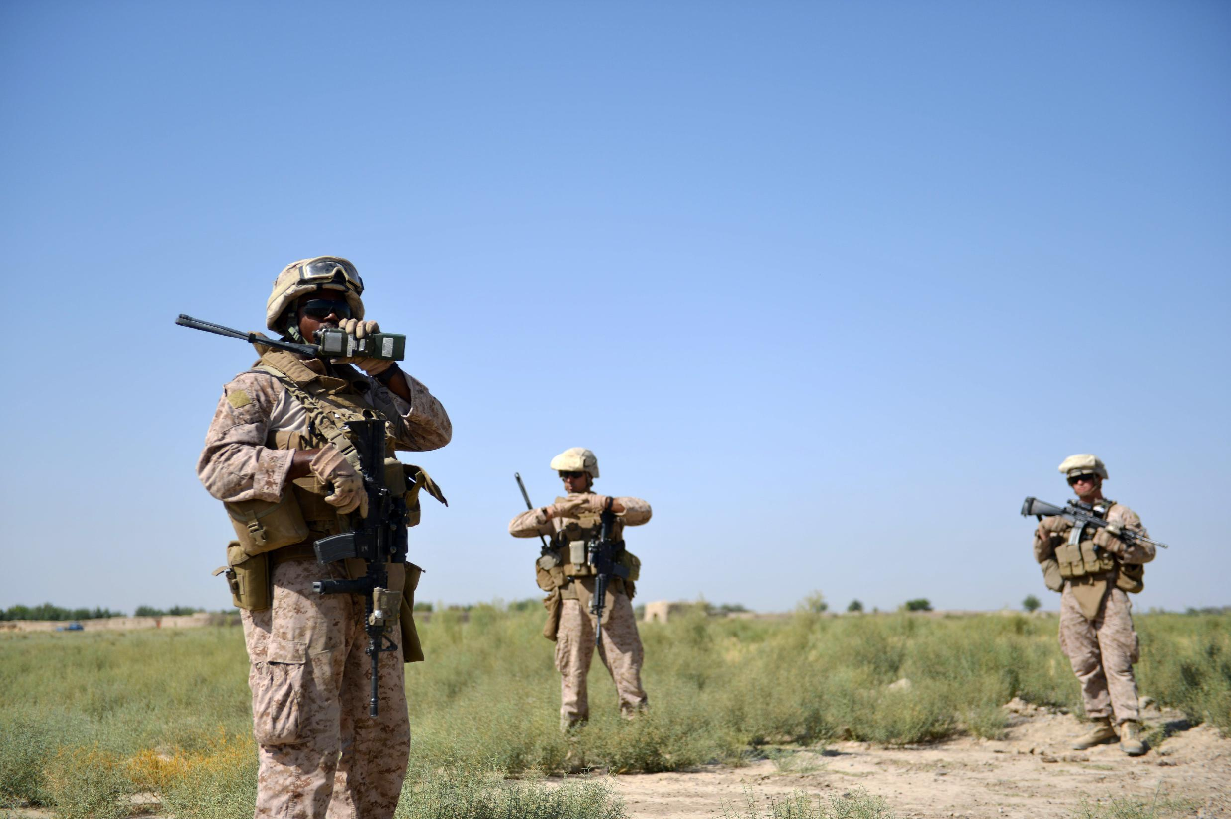 US Marines from Kilo Company of the 3rd Battalion 8th Marines Regiment conduct a patrol in Garmser, Helmand Province on June 29, 2012