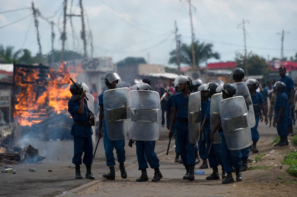 Demonstrators, police and government supporters, thought to be members of the ruling party's Imbonerakure militia, clashed in the capital Bujumbura (AFP Photo/Phil Moore)