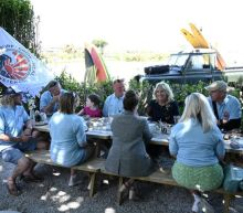 Surfboards and calming waters, U.S. first lady meets UK military veterans
