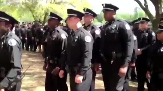 JPD Officers file into Detective Smith's funeral