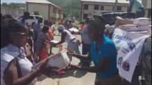 Hurricane victims in US Virgin Islands receive thousands of boxes of supplies through Adopt-a-Family program