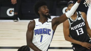 Magic's Isaac wheeled off court with torn ACL