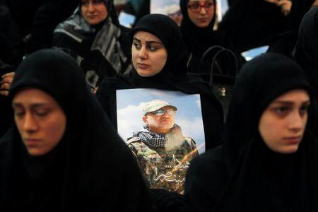Women carry pictures of Hezbollah commander Mustafa Badreddine, who was killed in an attack in Syria, during a ceremony marking a year after his death in Beirut's southern suburbs, Lebanon May 11, 2017. REUTERS/Aziz Taher