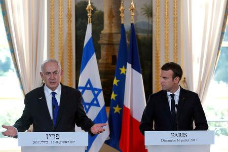 French President Emmanuel Macron and Israeli Prime Minister Benjamin Netanyahu attend a news conference to make a joint declaration at the Elysee Palace in Paris, France, July 16, 2017. REUTERS/Stephane Mahe