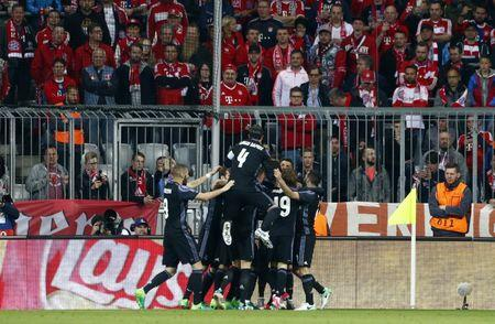 Real Madrid's Cristiano Ronaldo celebrates scoring their first goal with team mates