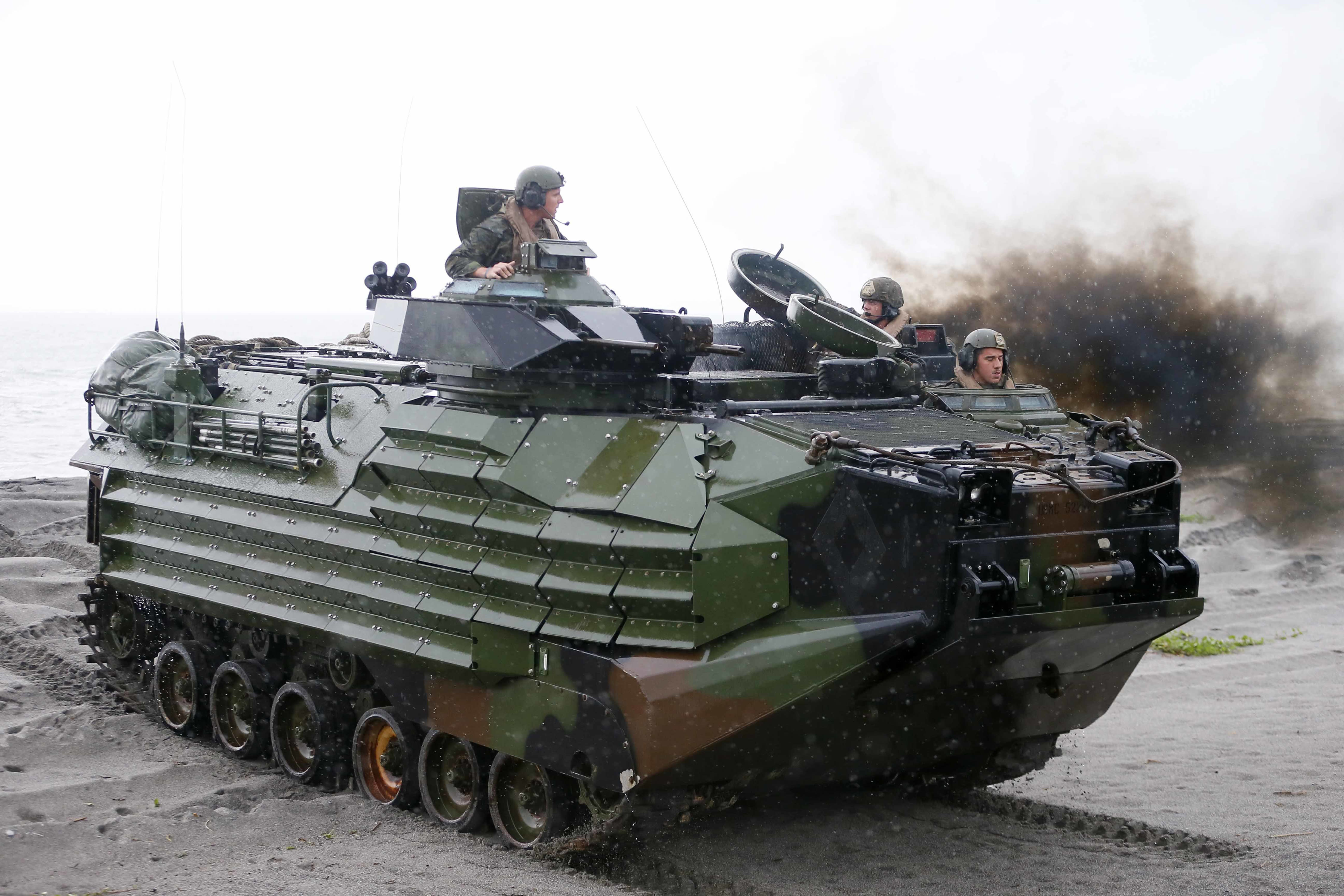 FILE - U.S. Marines from the 3rd Marine Expeditionary Brigade ride on their Amphibious Assault Vehicle (AAV) during the joint US-Philippines amphibious landing exercise Friday Oct.7, 2016 at Naval Education Training Command in San Antonio northwest of Manila, Philippines. A training accident off the coast of Southern California in an AAV similar to this one has taken the life of one Marine, injured two others and left eight missing Thursday, July 30, 2020. In a Friday morning tweet, the Marines say the accident happened Thursday and search and rescue efforts are underway with support from the Navy and Coast Guard. (AP Photo/Bullit Marquez, File)