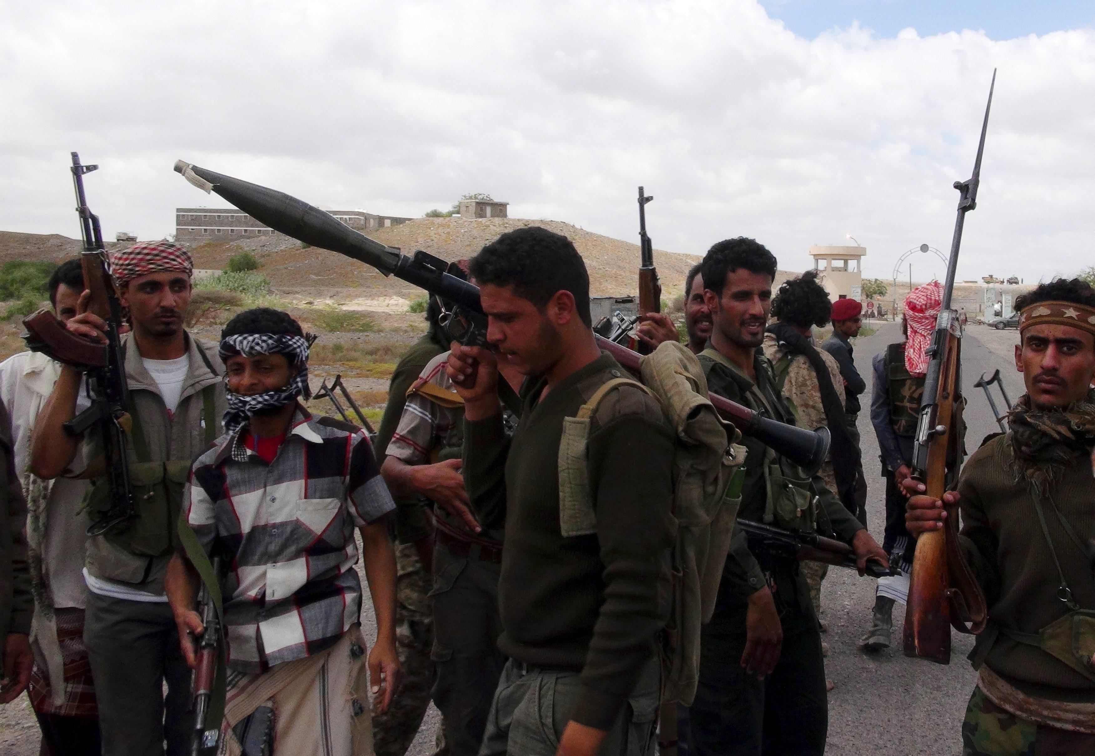 Southern People's Resistance militants loyal to Yemen's President Abd-Rabbu Mansour Hadi gather at the al-Anad air base in the country's southern province of Lahej, after seizing it March 22, 2015. Houthi fighters opposed to Yemen's president took over the central city of Taiz in an escalation of a power struggle diplomats say risks drawing in neighboring oil giant Saudi Arabia and its main regional rival Iran. Residents of Taiz, on a main road from the capital Sanaa to the country's second city of Aden, said that Houthi militias took over the city's military airport without a struggle from local authorities late on Saturday. REUTERS/Nabeel Quaiti TPX IMAGES OF THE DAY