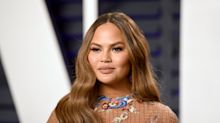 Chrissy Teigen calls Fox News host a 'white supremacist' for mocking her being on Time's most influential list