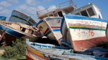 Sicily launches inquiry into fire in 'migrant boats graveyard'
