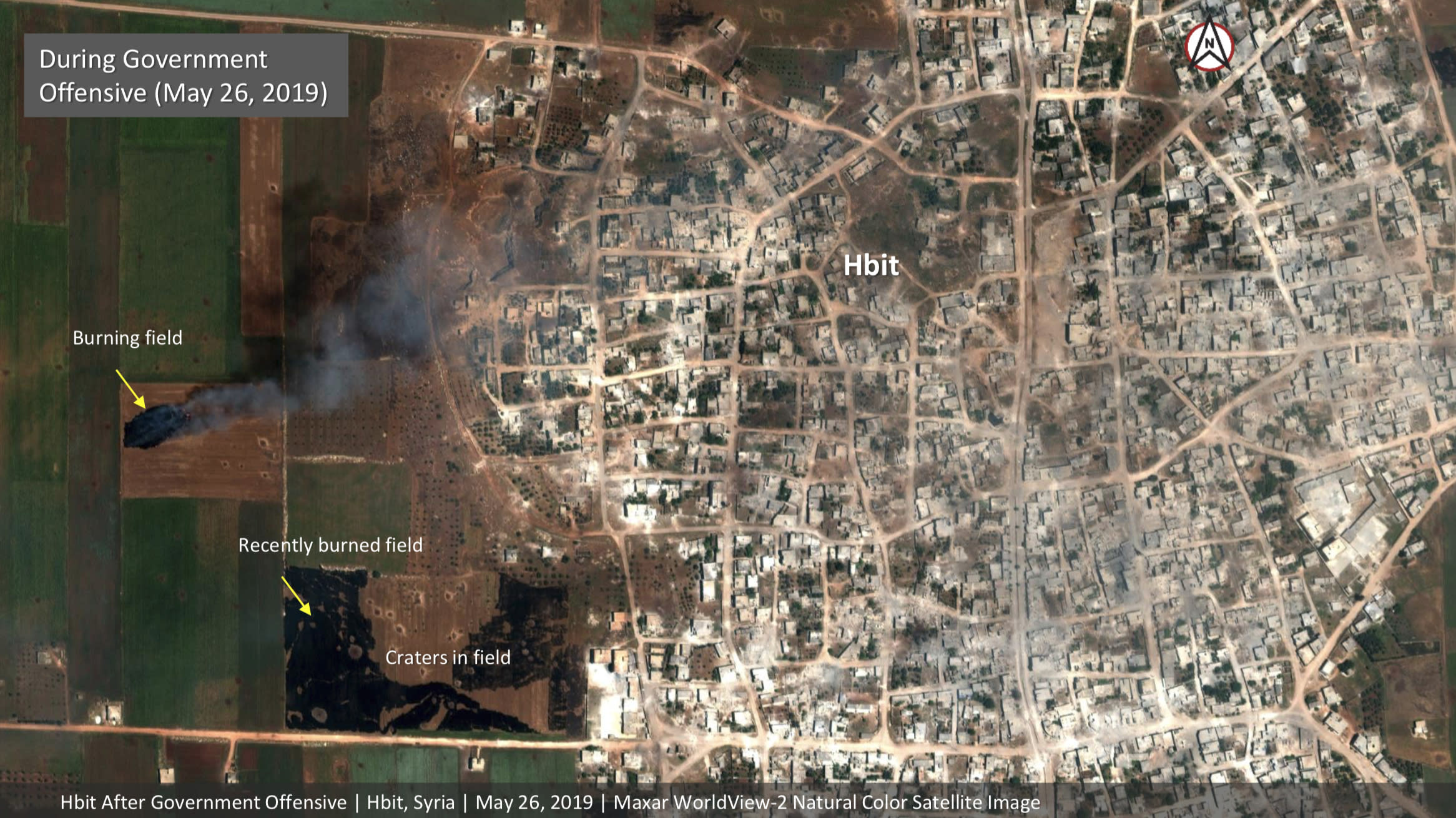 This satellite image provided by Maxar Technologies on Tuesday, May 28, 2019 shows significant damage to Habeet, Syria on May 26 as a result of a government offensive against the last rebel stronghold in the country. The images, provided to the Associated Press by the Colorado-based Maxar Technologies show fire still raging in olive groves and orchards during harvest season around Kfar Nabudah and Habeet, two villages on the edge of Idlib province where fighting has focused. (Maxar Technologies via AP)