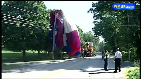 Hot air balloon gets tangled in power lines in Hampstead