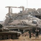 Syria seeks to crush insurgent pocket, denies evacuation deal