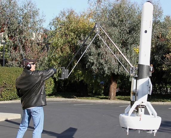So this is how it ends: DARPA demos a flying drone with a 6-foot claw (video)