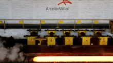 ArcelorMittal sees small steel demand rise, shares slip on margin concerns