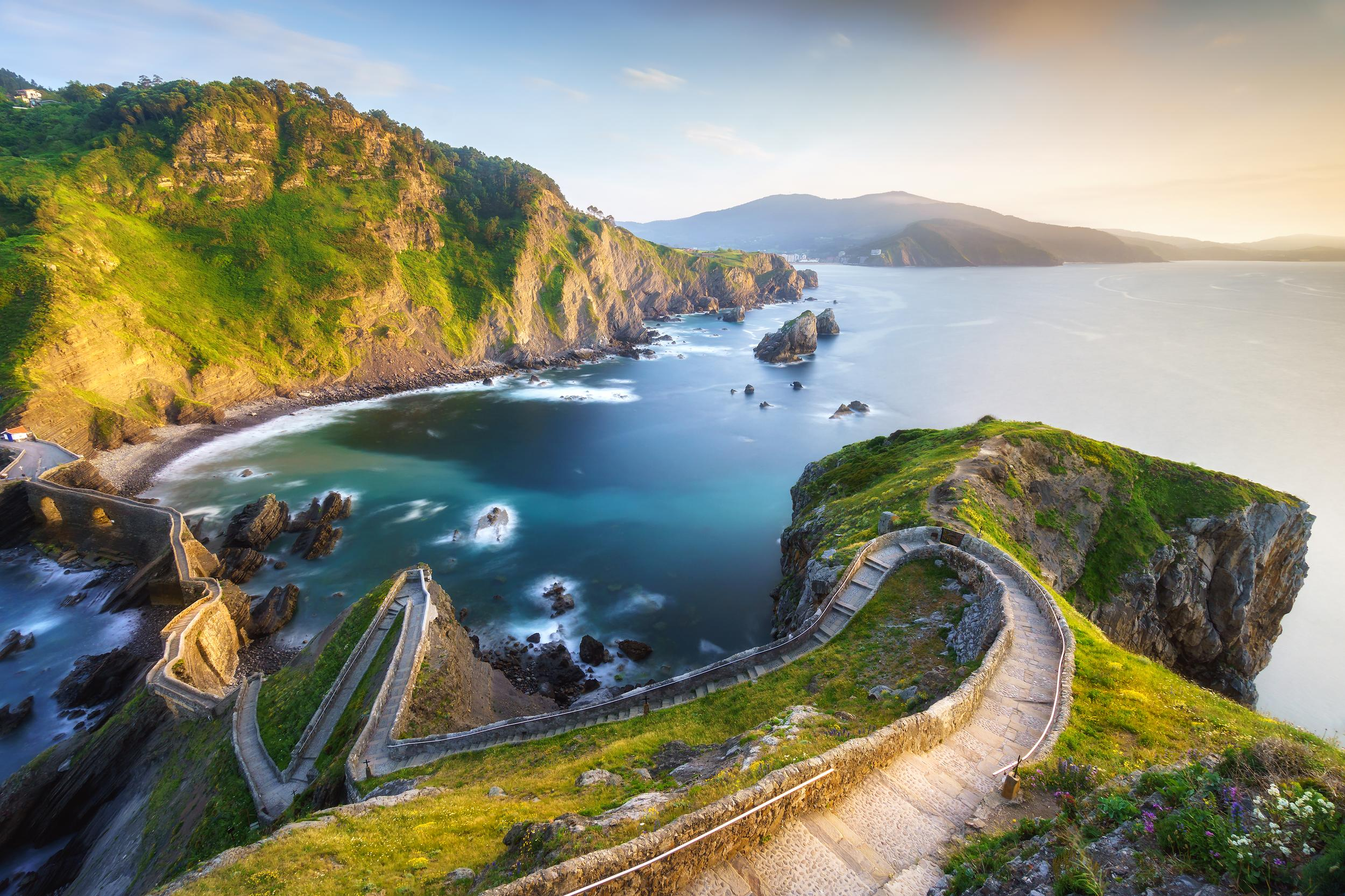 """<p><strong>GOT location</strong>: Dragonstone</p>  <p><strong>Real life location</strong>: San Juan de Gaztelugatxe, Spain</p>  <p>Get on a boat and channel your innerDaenerys Targaryen by visiting the stairs ofSan Juan de Gaztelugatx -- otherwise known as Dragonstone.</p>  <p><a href=""""https://fave.co/2GqmPJE""""><strong>Book your trip.</strong></a></p>"""