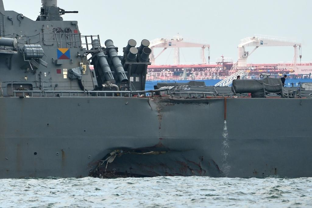 A gaping hole is visible in the port side of the USS John S. McCain after a collision with oil tanker that killed 10 sailors (AFP Photo/ROSLAN RAHMAN)
