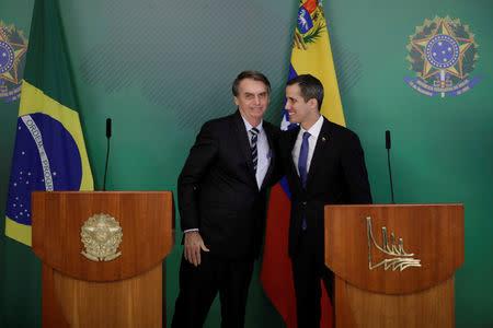 Venezuelan opposition leader Juan Guaido greets Brazil's President Jair Bolsonaro after a meeting in Brasilia, Brazil February 28, 2019. REUTERS/Ueslei Marcelino