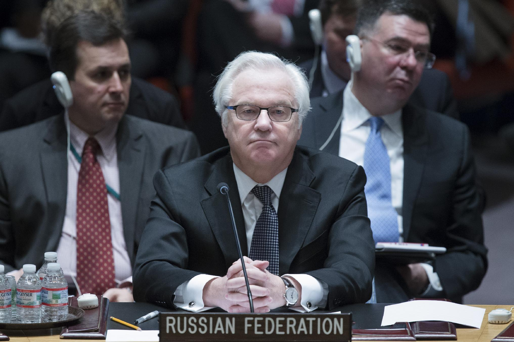 Russia's U.N. Ambassador Vitaly Churkin listens during a U.N. Security Council meeting on the Ukraine crisis, Saturday, March 15, 2014, at United Nations headquarters. (AP Photo/John Minchillo)