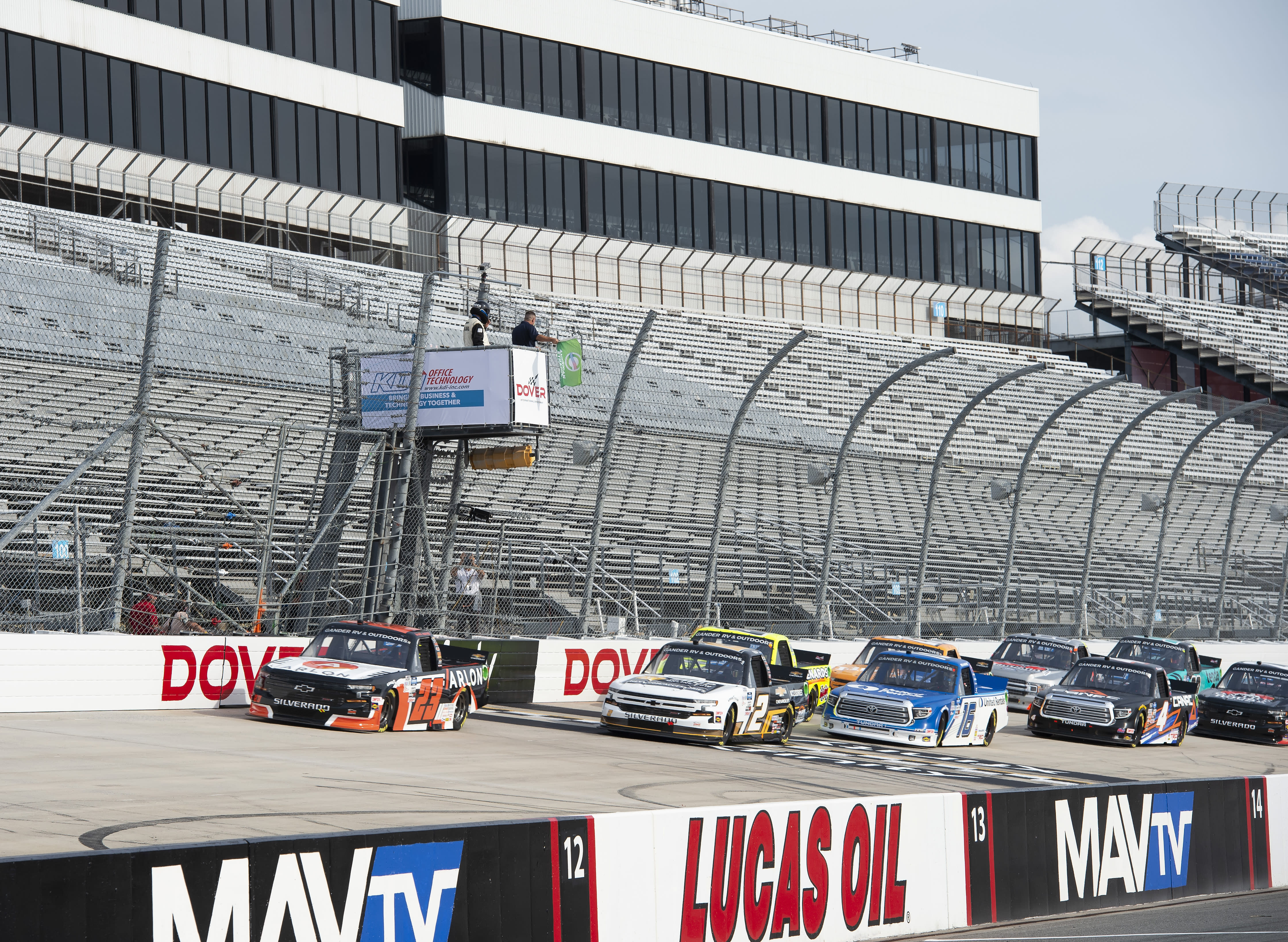 The field takes the green flag at the start of the NASCAR Truck Series auto race at Dover International Speedway, Friday, Aug. 21, 2020, in Dover, Del. (AP Photo/Jason Minto)