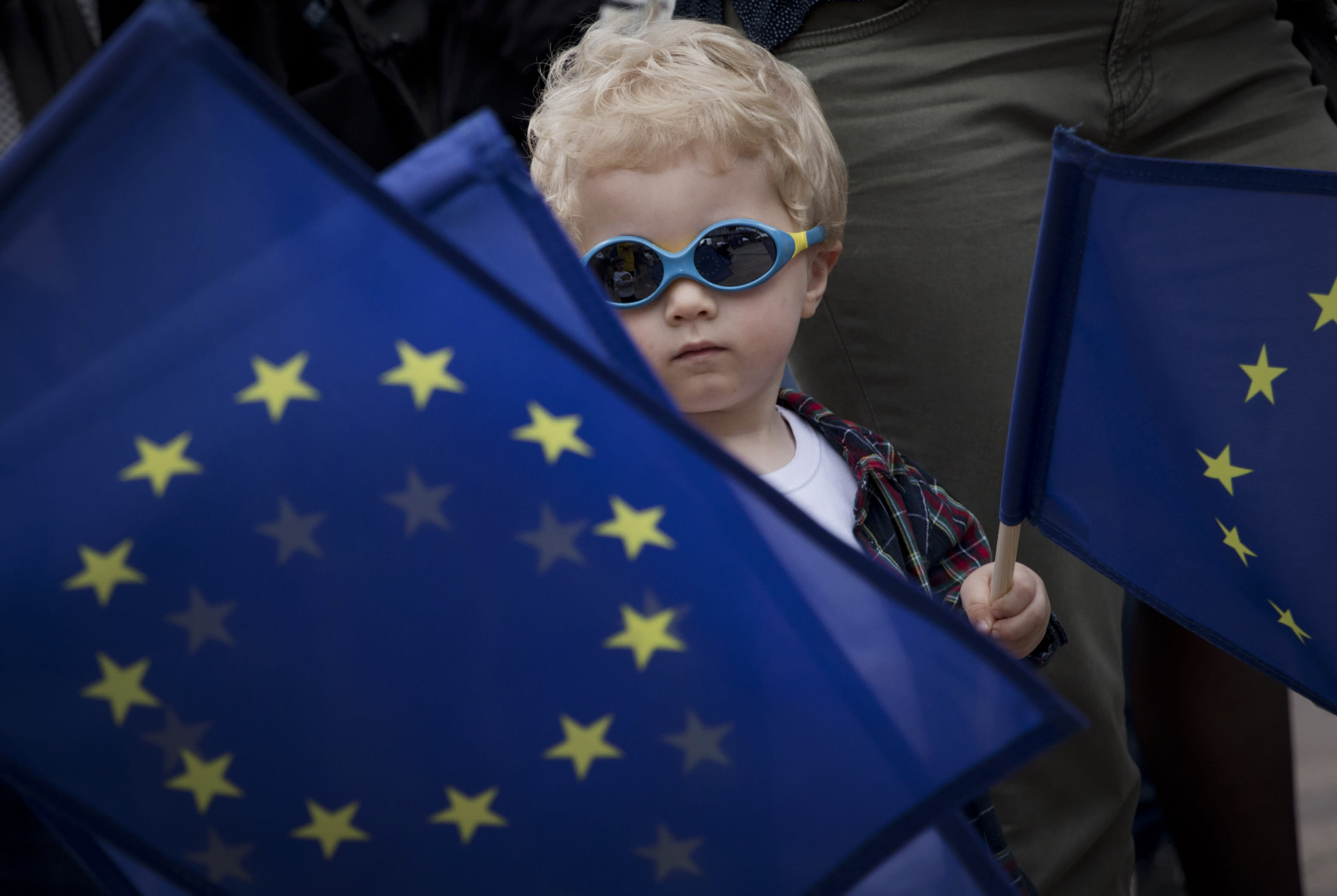 A young boys waves an EU flag during a festival outside the European Parliament in Brussels, Sunday, May 26, 2019. From Germany and France to Cyprus and Estonia, voters from 21 nations went to the polls Sunday in the final day of a crucial European Parliament election that could see major gains by the far-right, nationalist and populist movements that are on the rise across much of the continent. (AP Photo/Virginia Mayo)