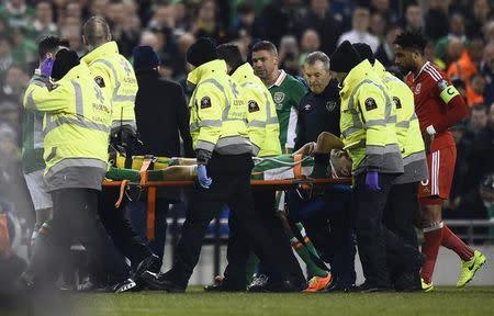 Republic of Ireland's Seamus Coleman is stretchered off injured