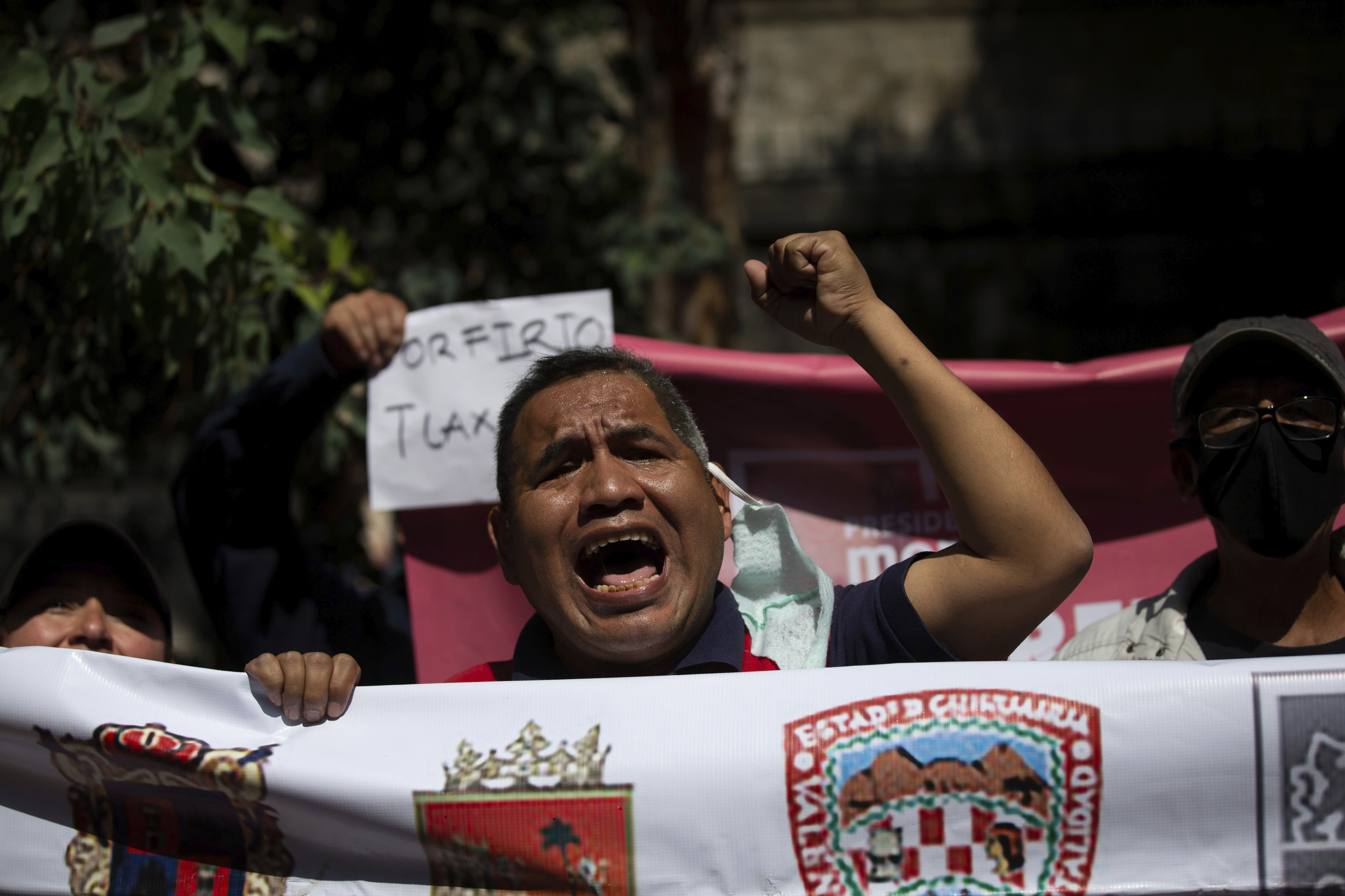 Supporters of Porfirio Munoz Ledo gather outside Morena party headquarters, amid elections to select the party's leader in Mexico City, Monday, Oct. 12, 2020. The ruling party is making its third try at electing a party leader. (AP Photo/Fernando Llano)