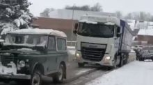 Incredible video shows 1972 Land Rover pulling lorry up snowy slope